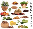 Healthy super food collection of fresh and dried fruit, herbs, pulses and nuts, very high in antioxidants and vitamins, isolated over white background. - stock photo