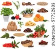 Healthy super food collection of fresh and dried fruit, nuts, herbs, spices, and pluses, very high in antioxidants and vitamins, isolated over white background. - stock photo
