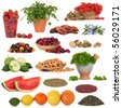 Healthy super food collection of fruit, herbs, pulses and nuts, very high in antioxidants and vitamins, isolated over white background. - stock photo