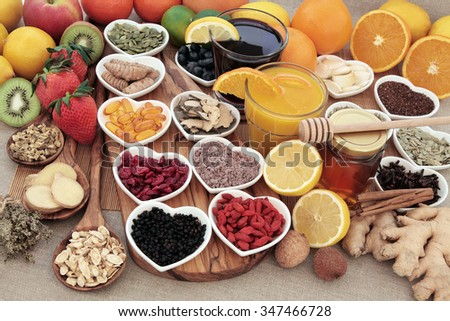 Healthy super food for cold remedy with fruit, orange and blackcurrant drinks, vitamin c supplement capsules, honey and medicinal herbs and spices, high in antioxidants. - stock photo