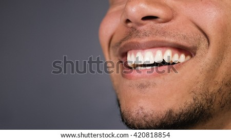 Healthy teeth of a male as he smiles at something, space for text