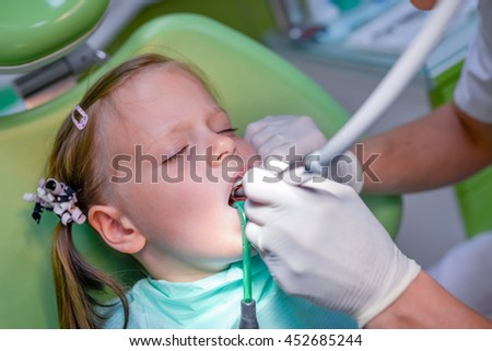 Healthy teeth patient girl in dentist office - dental caries prevention - stock photo