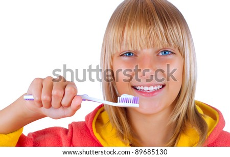 Healthy Teeth.Teenage Girl brushing her teeth - stock photo