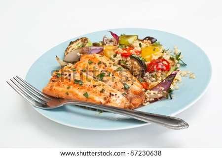 Healthy Trout with Roast Vegetables and Couscous on White Background - stock photo