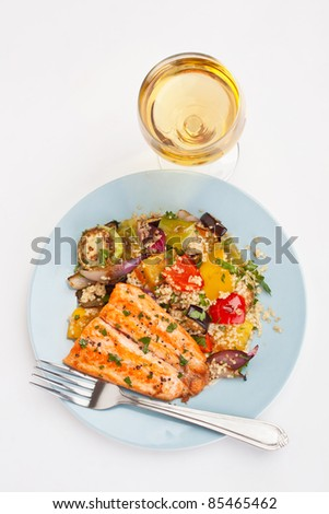 Healthy Trout with Roast Vegetables and Couscous Salad on White Background - stock photo