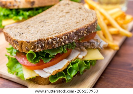 Healthy Turkey Breast, Ham, Cheese and Vegetables Sandwich on whole wheat bread - stock photo
