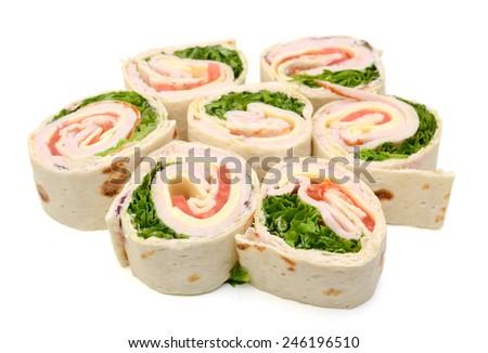 healthy turkey wrap sandwich with lettuce, tomato - stock photo