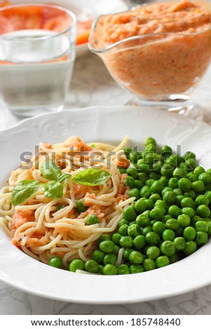 Healthy Vegan meal. Pasta with tomato sauce and green peas - stock photo