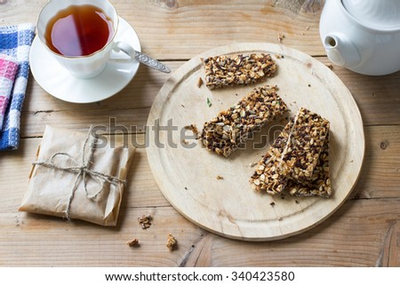 Healthy vegan snack. Homemade Oats and quinoa muesli bars on rustic table - stock photo