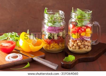 healthy vegetable chickpea salad in mason jar - stock photo