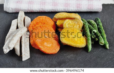 Healthy vegetable chips, dried, fried vegetables. dry green beans, eggplant dry, dry carrots and dried radish, pumpkin - stock photo