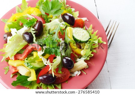 Healthy vegetable fresh organic salad on the white table - stock photo