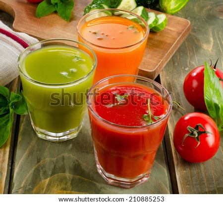 Healthy vegetable  juices on a wooden table. Selective focus