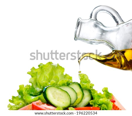 Healthy Vegetable Salad with Olive oil dressing isolated on white background. Pouring Olive oil. Healthy vegetarian food. Vegan. Diet, dieting concept. Lettuce, tomatoes, cucumbers. Organic bio food - stock photo