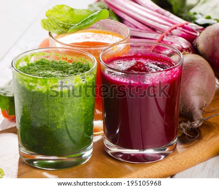 Healthy vegetable smoothie and juice. Selective focus - stock photo
