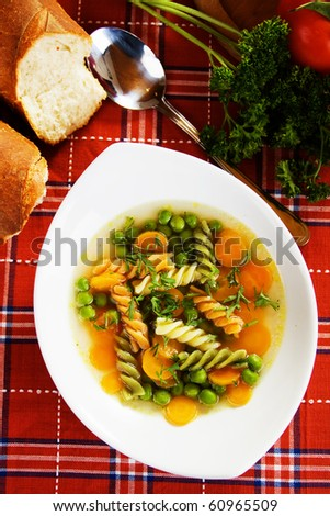 Healthy vegetable soup with carrot, green peas and noodles