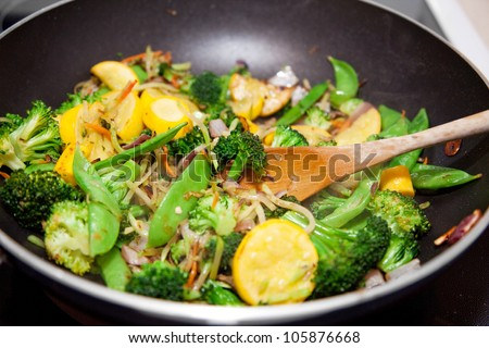 Healthy vegetable stir fry cooked in a Chinese style wok. - stock photo