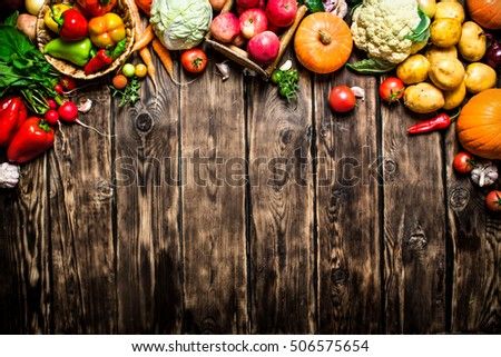 Healthy vegetables. Fresh vegetables with herbs. On wooden background.