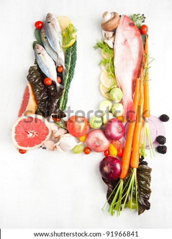 Healthy Vegetables, Meats, Fruit and Fish Shaped in Number Four 4 - stock photo