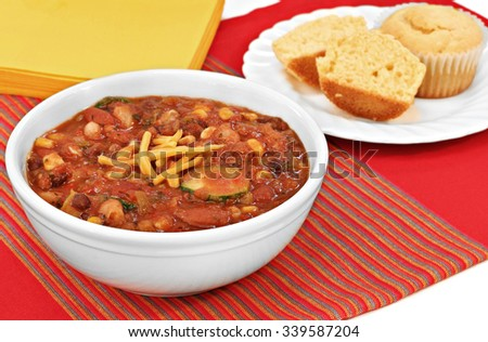 Healthy, vegetarian chili with corn muffins prepared with organic vegetables. - stock photo