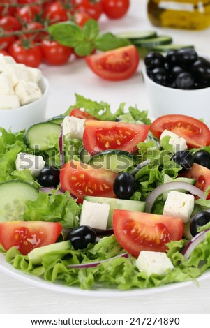 Healthy vegetarian eating Greek salad in bowl with tomatoes, Feta cheese, onions and olives - stock photo