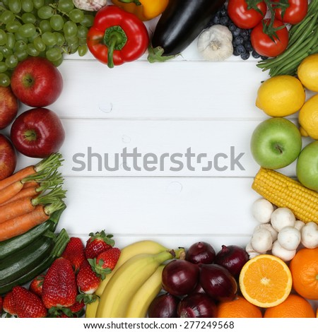 Healthy vegetarian or vegan food frame from vegetables and fruits with copyspace - stock photo