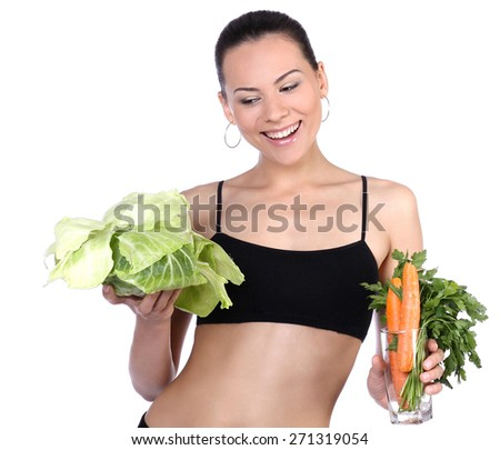 Healthy vegetarian woman holding vegetables and smiling on a white background. - stock photo