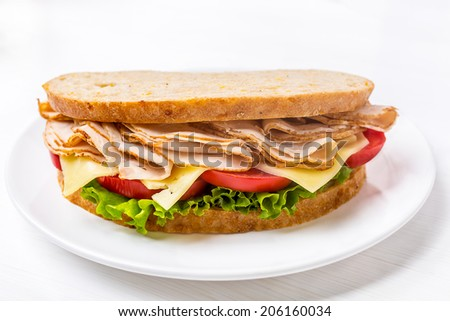 Healthy Wafer Thin Roast Turkey Breast, Cheese, Fresh Tomato and Lettuce Sandwich