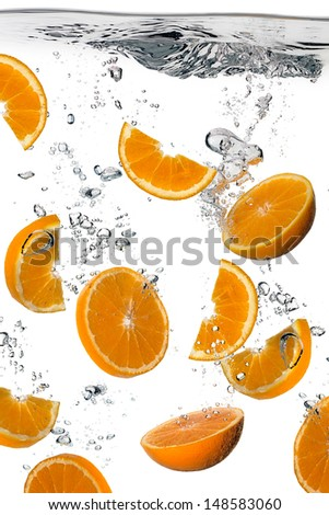 Healthy Water with Fresh Oranges. Splash isolated on white - stock photo