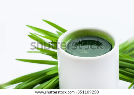 Healthy way of life. Energy from nature. Ecological wheat-grass juice. Regenerate your cells  stop ageing processes and detoxicate your body. High key isolated on white.