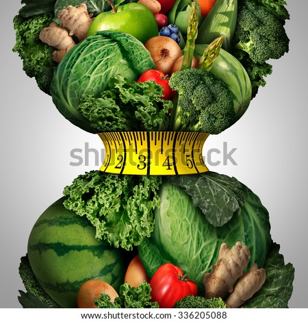 Healthy weight loss diet as a group of fresh fruits and vegetables with a fitness tape measure wrapped around a tight shrinking waistline shape as a metaphor for healthy lifestyle weightloss. - stock photo