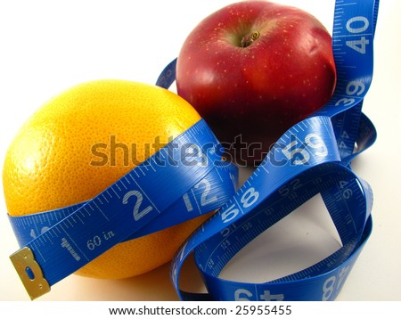 Healthy Weight Management with Fruit and Measuring Tape - stock photo