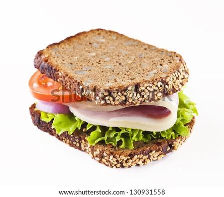 Healthy whole grain bread sandwich with ham - stock photo