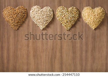 Healthy whole grains shaped like hearts - stock photo