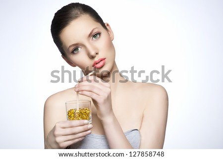 Healthy Woman holding glass full of pills - stock photo