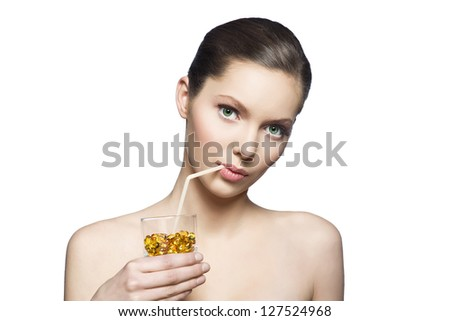 Healthy Woman holding glass with pills - stock photo