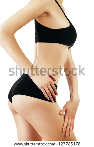healthy woman in black lingerie on white background - stock photo