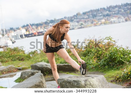 Healthy woman stretching before an outdoor run