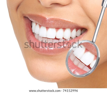 Healthy woman teeth and a dentist mouth mirror - stock photo