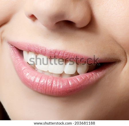 Healthy woman teeth and smile. Close up - stock photo