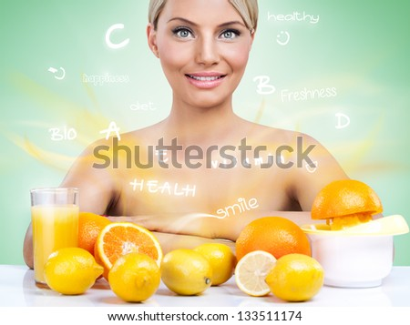 Healthy woman with citrus fruits and flying words - stock photo