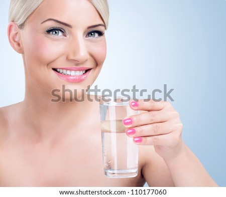 Healthy woman with glass of water - stock photo