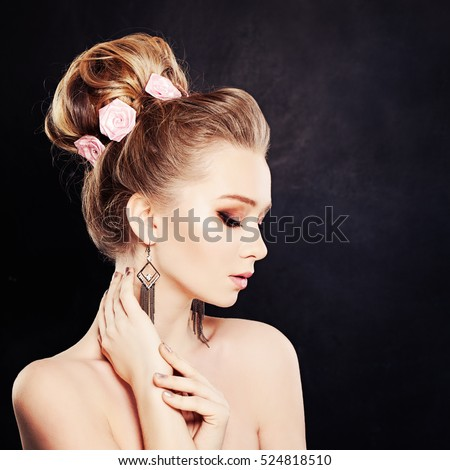 Healthy Woman with Makeup and Bridal Hairstyle with Rose Flowers