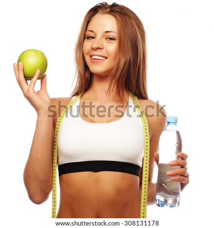 Healthy woman with water and apple diet smiling isolated on white - stock photo