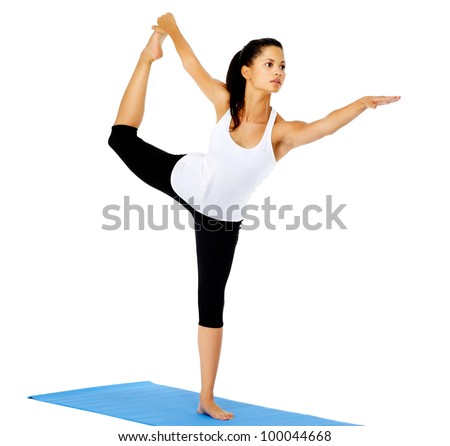Healthy yoga woman does stretch on mat. This is part of a series of various yoga poses by this model, isolated on white - stock photo