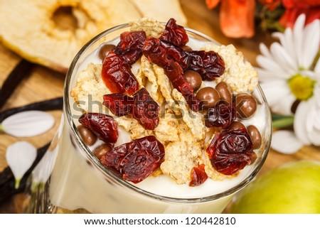 Healthy yogurt, muesli and berries in glass - stock photo