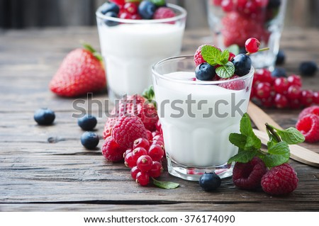 Healthy yogurt with mix of berry, selective focus - stock photo