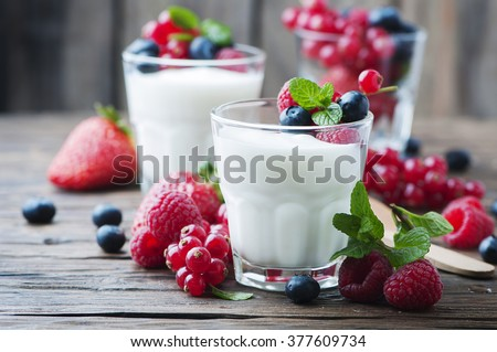 Healthy yougurt with mix of berry, selective focus - stock photo