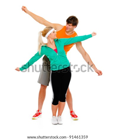 Healthy young female and man in sportswear having fun isolated on white - stock photo
