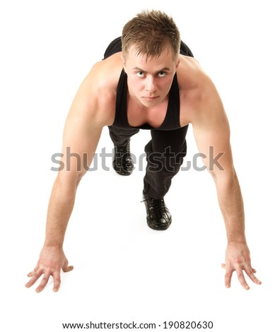 Healthy young man at start line ready for run race and win. Isolated - stock photo